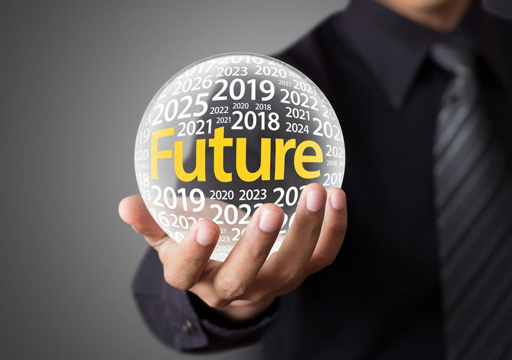 Person Holding a Crystal Ball Showing Future Years Inside